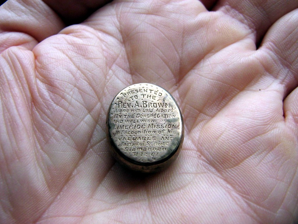 A unique piece of Parish History inscribed on the back of a gold Watch Fob.