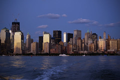 Night falls on New York City skyline on the Hudson River (jackie weisberg) Tags: city newyorkcity sunset sky usa newyork water skyline architecture night america skyscraper buildings reflections river boats boat skyscrapers nightshot manhattan batterypark american rivers hudsonriver newyorkstate northeast dramaticskyline jackieweisberg
