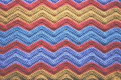 222.365: the completed chevrons (Lisa | goodknits) Tags: blue orange colors yellow ripple stripes crochet blanket periwinkle finished chevron zigzag babyblanket crocheting