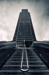Majestic (Philipp Klinger Photography) Tags: light shadow sky bw white house black paris france reflection building tower glass lines architecture clouds stairs contrast skyscraper reflections dark la blackwhite nikon frankreich europa europe stair ledefrance tour metro mtro first ladefense symmetry