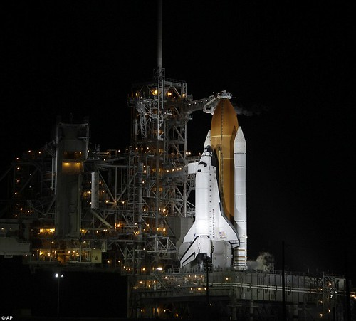 Let's light her up one last time! Atlantis overcomes a shaky launch to become the final Nasa shuttle to blast into space  18