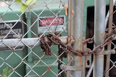 Chain (AndyM.) Tags: sign metal canon fence rust decay southcarolina rusty chain chainlink travelersrest 60d