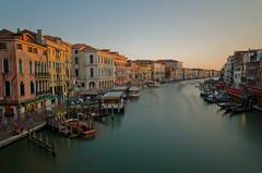 Last Light over Venice - [EXPLORED] (andreaskoeberl) Tags: longexposure bridge venice light italy orange rialtobridge water boats evening canal nikon ships rialto ndfilter 1685 d7000 nikon1685 nikond7000 andreaskoeberl