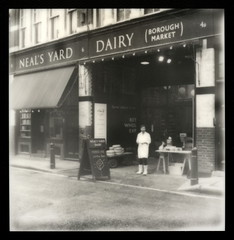 Neal's Yard Dairy (Borough Market) (tobysx70) Tags: park street uk toby summer bw white man black slr london wheel sepia cheese yard silver project polaroid sx70 pod market coat uv poor july tip shade 600 frame week borough hancock dairy 680 impossible neals roid the px 2011 roidweek silvershade theimpossibleproject px600uv tobyhancock impossaroid