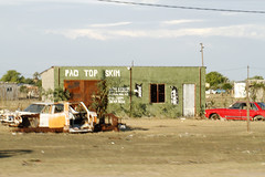 Pac Top Skim (cowyeow) Tags: poverty africa street old silly green cars bar weird town crazy funny village sad top african empty bricks wrong alcohol badsign booze rough decrepit namibia funnysign dilapidated wrecks pac rundown skim namibian uglybuilding funnyname ruacanafalls ruacana crapsign funnyafrica