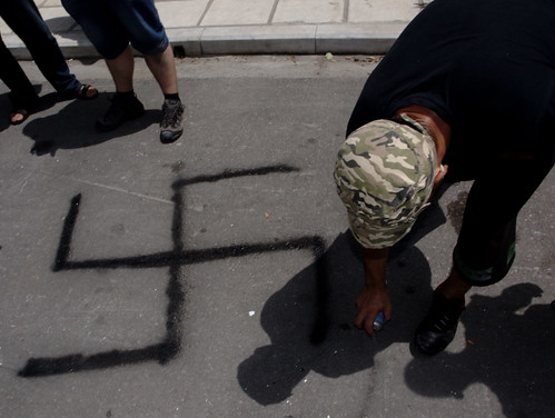 Greek members of the Indignant protest movement spray swastika outside German consulate, Thessaloniki by Teacher Dude's BBQ