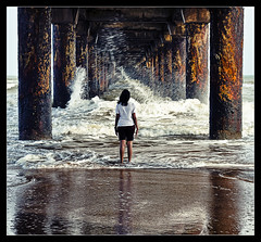stay calm..even when the world goes haywire (PNike (Prashanth Naik)) Tags: bridge sea woman india storm reflection water lady pier interestingness interesting nikon asia waves under splash pillars andhra vizag splashing visakhapatnam d7000 pnike