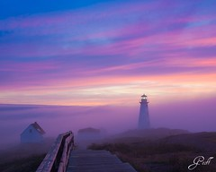 Fogged in at Cape Spear (gwhiteway) Tags: morning travel pink light summer plants lighthouse canada tourism home nature colors rock fog clouds sunrise newfoundland buildings path steps foggy stjohns 15 historic atlantic luck lucky cape minutes spear timing capespear ocen platinumheartaward flickraward flickraward5 mygearandme mygearandmepremium mygearandmebronze mygearandmesilver mygearandmegold gearandmebronze artistoftheyearlevel3 artistoftheyearlevel4 TGAM:photodesk=summer artistoftheyearlevel5 artistoftheyearlevel6