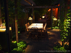 Outdoor Dinning Room ~ Minnesota Landscape Design inspired by Bali ~ Antique Clay Paver Walk & Patio / Custom Cedar Pergola / Low-Voltage Landscape Night Lighting (Switzer's Nursery & Landscaping) Tags: bali water minnesota design waterfall pond natural landscaping glenn patio cedar handcrafted waterfeature northfield interlocking pergola paver pavers balinese switzers arbour switzer 12volt landscapedesign designbuild hardscape uplights lowvoltage outdoorliving downlights hardscaping landscapelighting customdesigned pathlights glennswitzer naturalpond icpi mnla outdoordinning patiodesign landscapepond pergoladesign switzersnursery landscapedesigns theartoflandscapedesign switzersnurserylandscaping arbourdesign artoflandscapedesign minnesotanurserylandscapeassociation