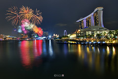 The Night That The Lights Never Went Out | Part 10 | Singapore NDP fireworks 2011 (naza.carraro) Tags: show park city travel blue light party vacation holiday color water festival museum architecture marina river geotagged happy fire bay sand nikon singapore asia fireworks joy happiness quay celebration hour clark esplanade ndp cbd fullerton merlion temasek singapura mbs raffles sungai ntuc kallang maybank 2011 naza artscience naza1715 nazarudin