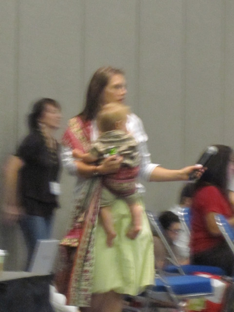 BlogHer Mic Wrangler wearing a baby