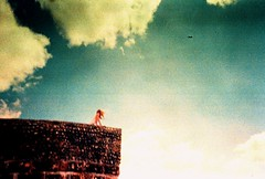 Summer breeze (fotobes) Tags: film girl clouds vintage happy sussex lomo lca xpro lomography crossprocessed brighton wind accident crossprocess grain crossprocessing grainy breeze brightonbeach knackered lowfi summerbreeze xprosky lomographychrome100 fotobes