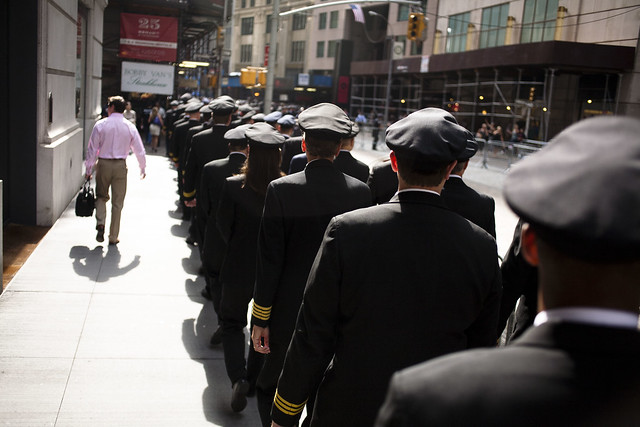 Pilots walk down Broad Street, near Stock Exchange