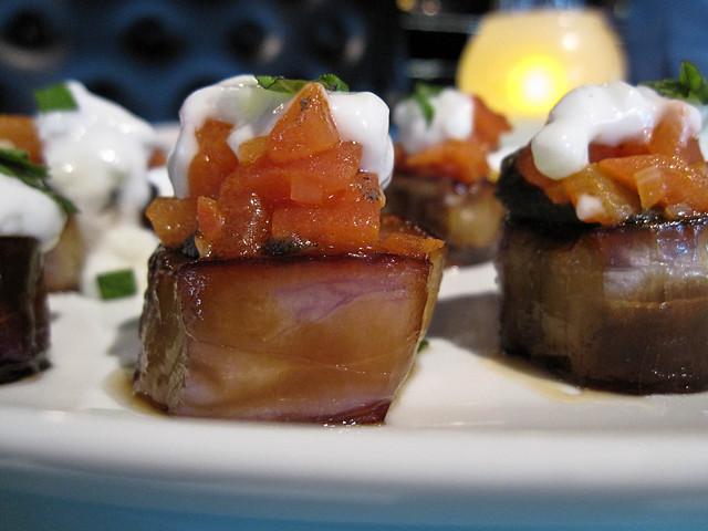 Sweet and sour eggplant, baba ghanoush, yogurt, tomato