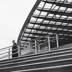 humans in steel spaces (StephenCairns) Tags: street blackandwhite bw glass station businessman stairs work steel streetphotography explore trainstation commute handrail railing gifu beams salaryman steelbeams   blacksuit japanesebusinessman 30mmsigmaf14 canon50d japanesesalaryman steelrailings  gifustation