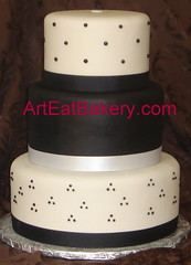 Three tier custom designed black and white fondant round wedding cake with swiss dots and ribbons (arteatsbakery) Tags: wedding sc cake modern ga idea design photo nc designer unique weddingcake picture columbia anderson bakery custom greenville clemson mauldin spartanburg fondant cakedecorator simpsonville