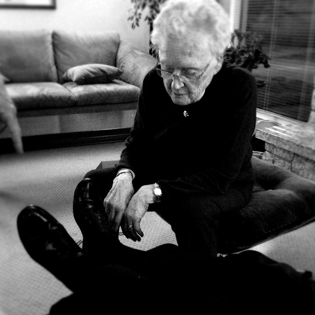 my grandmother tying my grandfather's shoes