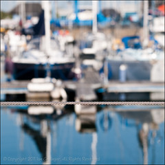 Beyond The Fence (*ian*) Tags: ocean sea reflection water metal sailboat marina fence square reflecting boat wire niceshot bokeh yacht metallic twist vessel cable hampshire h2o fluid reflect solent southampton favourite liquid saltwater hythe seawater southamptonwater hythemarina hythemarinavillage bigemrg gettysubmitted