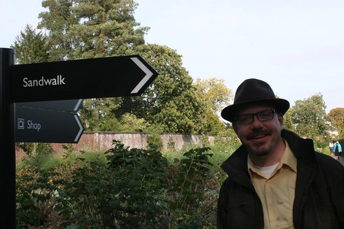 John Hawks at the Sandwalk sign at Down House