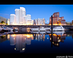 Dusseldorf, Germany (Popeyee) Tags: pictures new city blue sunset red urban white haven reflection building art water architecture modern night facade port canon silver buildings reflections germany frank deutschland photography evening photo twilight media shiny gallery cityscape foto image photos harbour picture landmark gehry center images structure architectural architect fotos hour stadt architektur bluehour dusseldorf bild hafen dsseldorf rhine rhein frankgehry duesseldorf bilder neue masterpiece frankogehry huser neuerzollhof neuer 2011 zollhof rhin mediahafen mediaharbour gehrybuildings frankgehrybuildings frankowengehry frankgehryhuser artandmediacenter