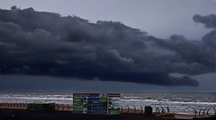 Storm Brewing (Smirfman) Tags: uk sunset sea england sun storm water rain clouds seaside northwest wind sony lancashire alpha blackpool goldenhour violent a550