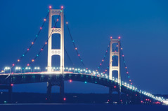 Mackinac Bridge Blues (pixelmama) Tags: blue michigan lakemichigan lighttrails bluehour gettyimages mackinacbridge beforesunrise starbursts hcs mackinawcity festivelights lakemichigancircletour frhwofavs clichsaturday pixelmama tpslandscape tpsbridge