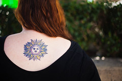 Sun Tattoo (JeezyDeezy) Tags: woman black tattoo redhair suntattoo centurycitymall