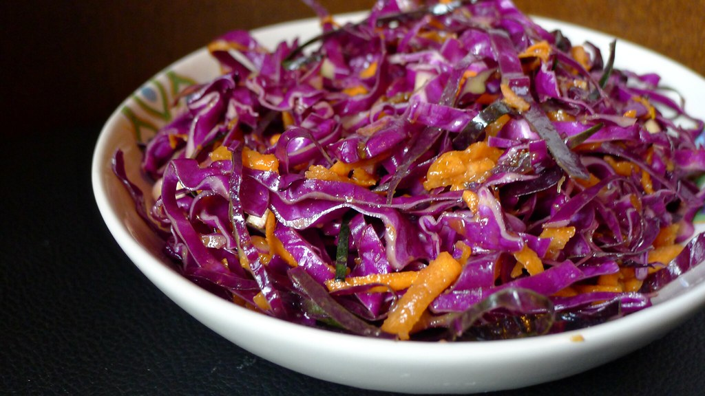 hot curried slaw in a pretty bowl