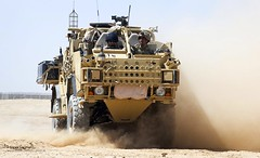 Singer Celebrity Cheryl Cole Drives a Jackal Armoured Vehicle  During a Visit to British Troops in Afghanistan