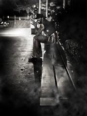 pimp goes limp (pimpdisclosure) Tags: bw black night bench cowboy smoke fedora pimp cowboyhat minipimp pimpexposure thehatchronicles pimpdisclosure thethirdshotmentionedinthestoryofpimpisonmyoldstreampimpexposure