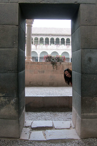 Grace peeking around a corner in Qorikancha