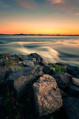 Sunset on the Rapids (philessing) Tags: longexposure sunset canada water river movement rocks quebec montreal 5d lachine canonef1740mmf4lusm hdr lightroom splittone fleuvesaintlaurent saintlawrenceriver canoneos5d photomatix lachinerapids nd110 parclachinerapids