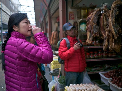 110822 Szu-ting and Eric checking out the dried meat in the market