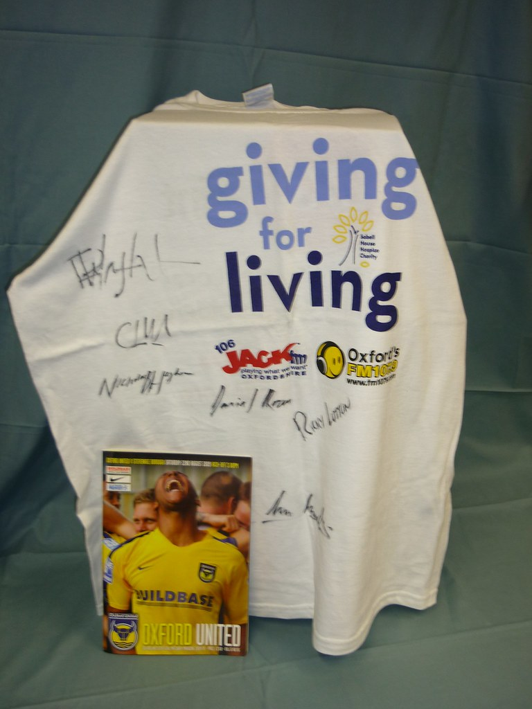 Jack FM Sobell House Giving for Living t-shirt signed by Oxford United players, with Oxford United v Stevenage match programme