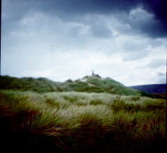 adam on the dunes (i was a tree in a past life.) Tags: sky clouds square lomo lomography mini diana format vignette