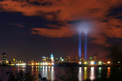 Tribute in Light (Moniza*) Tags: world city nyc light usa ny newyork night america port liberty newjersey nikon memorial jerseycity downtown cityscape searchthebest god manhattan nine 911 nj 9 center 11 explore hudsonriver wtc gothamist tribute september11 trade eleven bless liberte tributeinlight libertystatepark gothamcity thebigapple d90 freedomtower explored moniza photographerschoice~halloffame