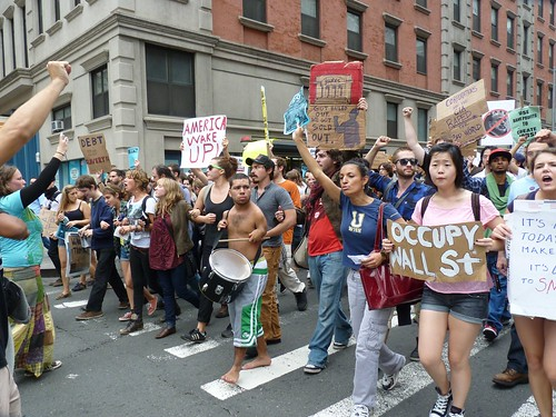 Occupy Wall Street marchers link arms, play drums on Church St