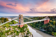 Clifton Bridge (LongLensPhotography.co.uk - Daugirdas Tomas Racys) Tags: city uk longexposure bridge pink trees light sunset red summer england sky cliff colour green cars night clouds contrast forest river bristol lights golden evening spring warm glow crossing view bright suspension dusk steel wide trails illumination somerset september cables toll vegetation late gorge avon clifton charge magichour westcountry brunel