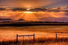 Sun Set On Summer (BigSkyKatie) Tags: ranch autumn sun mountains fall field silhouette set clouds fence landscape montana farm grain rays hay ennis setting madisonvalley bigskycountry katielasallelowery