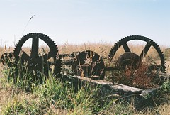 California (Zanna Allen) Tags: california road camera old trip autumn summer sky holiday slr abandoned industry film field grass metal america photography coast photo md rust industrial day allen mechanical ruin olympus visit september photograph american contraption fujifilm mm manual westport cogs 35 zanna om1 mechanism ruined 2011
