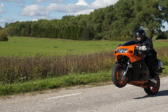 Wheelie with Orange Suzuki (tarmo888) Tags: people speed europe estonia sony helmet motorcycle suzuki asphalt speeding kiiver wheelie eesti actionshot estland asfalt racingbike orangecolor photoimage sooc oranz sonyalpha tartumaa gisteqphototrackr sony geosetter oran kiirus geotaggedphoto nex3 sel18200 year2011 foto