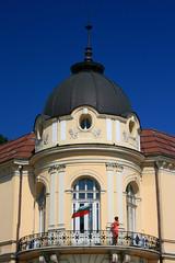 Balcony in Sofia (Brian Aslak) Tags: woman building corner europe sofia balcony flag bulgaria