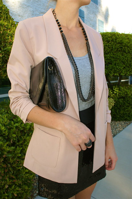 Peach blazer with black sequin skirt
