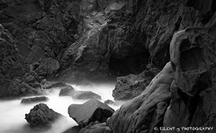 Pfeiffer Beach Mono (Silent G Photography) Tags: ocean california ca longexposure blackandwhite bw water monochrome mono rocks pacific bigsur explore highway1 noon nikkor midday pfeifferbeach explored lightroom3 nikond7000 1635mmf4 markgvazdinskas silentgphotography