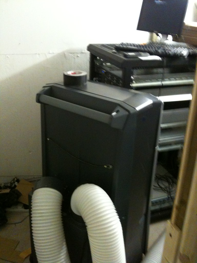 Portable air conditioning unit cooling a server room