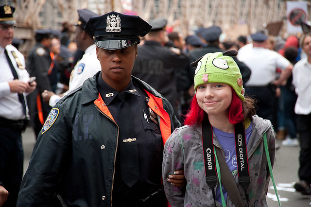 Girl in Green Hat Arrested: Occupy Wall Street Occupies the Brooklyn Bridge ©2011 Adrian Kinloch CC BY-NC-ND 2.0 - DOOM! Magazine