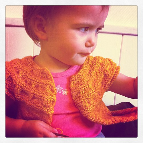 Everytime I try to #knit on this sweater she wants to try it on and have her photo taken. #knitting #tricot
