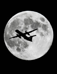 Horizon Airlines Flight 574 (phil_mcgrew) Tags: moon silhouette airplane aircraft fullmoon turboprop bombardier dehavilland alaskaair dhc8 earthandspace horizonairlines peopleandspace competition:astrophoto=2012