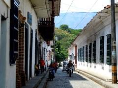 Santa Fe traffic (pilechko) Tags: street mountain santafe color window bike colombia motorbike shutters andes cobbles antioquia