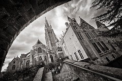 In Bruges 6/7: Onze Lieve Vrouwe Kerk (Allard Schager) Tags: city bridge sky blackandwhite bw tree church monochrome architecture clouds nikon europe cityscape belgium belgie zwartwit pov brugge surreal medieval boom september unescoworldheritagesite bruges brug unreal tilt dickens vignetting flemish kerk eclectic harsh bold architectuur churchofourlady contrasty flanders photogenic zw onzelievevrouwekerk vlaanderen veniceofthenorth capitalcity 2011 ultrawideangle 14mm traveldestinations middeleeuws famousplace fotogeniek singleraw nikcolorefexpro upwardangle gruuthuuse d700 bonifaciusbrug bonifaciusbri